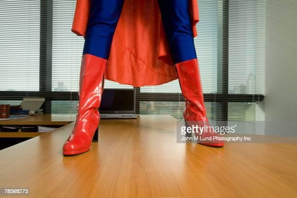 Superhero standing on desk
