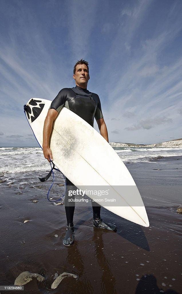 Superhero surfer : Stock Photo