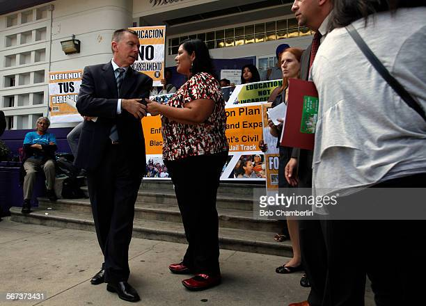 LAUSD superintendent Dr John Deasy talks to LAUSD board member Monica Garica after he announced a new program in which school police will no longer...