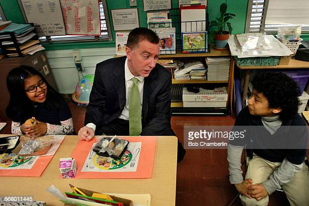 Superintendent John Deasy center jokes with Christopher Palma–Cruz right and Luisa Garcia left both 8 at Figueroa Street Elementary School as they...