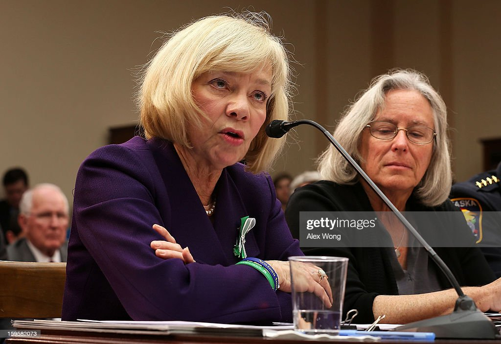 Superintendent of schools of Newtown, Connecticut, Janet Robinson (L) speaks as Emily Nottingham (R), mother of Gabe Zimmerman, a staff member to former Rep. Gabrielle Giffords' who was killed during the Tucson, Arizona shootings, listens during a hearing before the House Democratic Steering and Policy Committee January 16, 2013 on Capitol Hill in Washington, DC. The committee held a hearing to focus on 'Gun Violence Prevention: A Call to Action.'