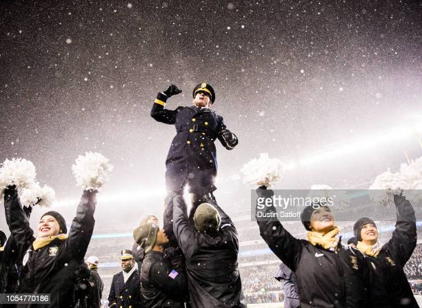 Superintendent of the United States Military Academy Lieutenant General Robert L Caslen Jr is held up by Army Black Knights Cheerleaders during the...