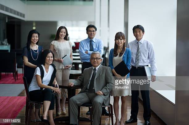 superior and colleagues of smile in office