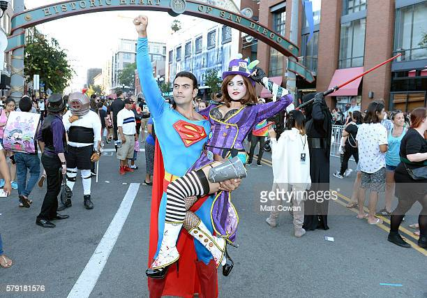 Superman and Mad Hatter cosplayers attend ComicCon International on July 22 2016 in San Diego California
