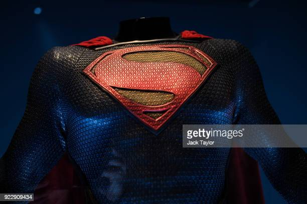 Superman costume from the 2013 Man of Steel film worn by Henry Cavill and designed by Michael Wilkinson and James Acheson is on display at the DC...