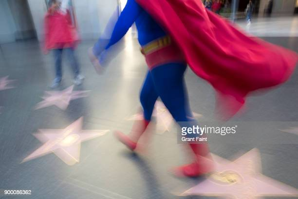 superman impersonator walking in famous walkway. - celebrity fake photos stock pictures, royalty-free photos & images