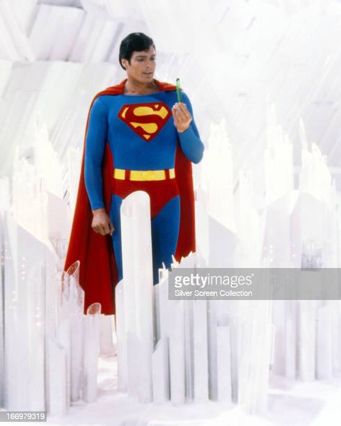 Superman played by American actor Christopher Reeve holds a green crystal at the Fortress of Solitude in a promotional still from 'Superman' directed...