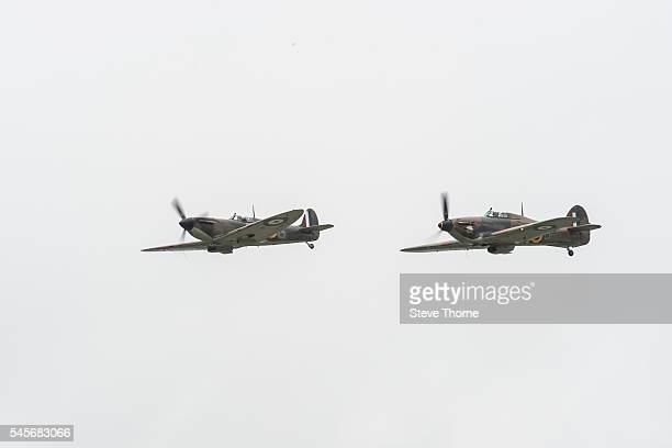 Supermarine Spitfire and Hawker Hurricane flying at RAF Fairford on July 9 2016 in Fairford England