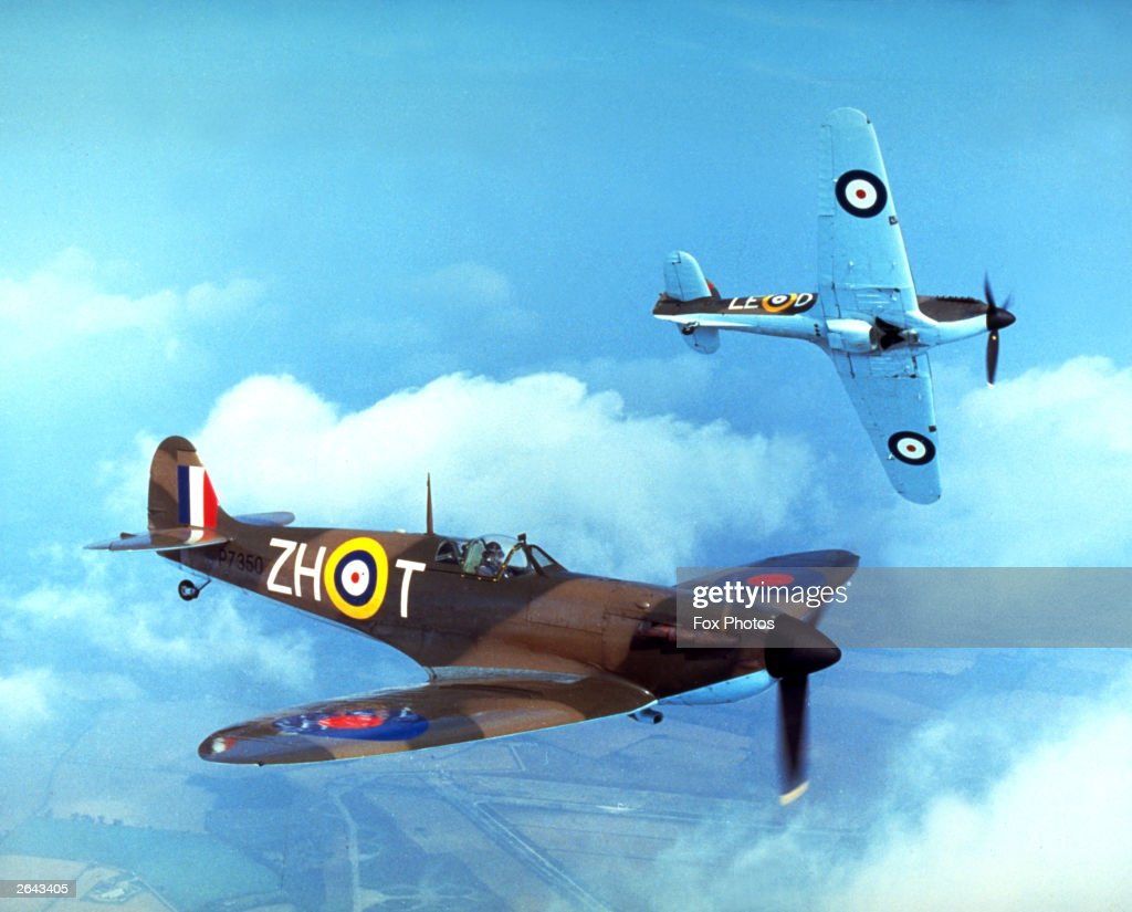 A Supermarine Spitfire IIa P7350 (foreround), and a Hawker Hurricane IIc LF363 with markings as they appeared in Guy Hamilton's film 'Battle Of Britain', 1969. Built in 1940, the Spitfire took part in the Battle of Britain, serving with 266 Squadron and 603 (City of Edinburgh) AuxAF Squadron. The Hurricane was built in 1944 and is believed to be the last Hurricane to enter service with the RAF. Both aircraft are still flying with the Battle of Britain Memorial Flight.