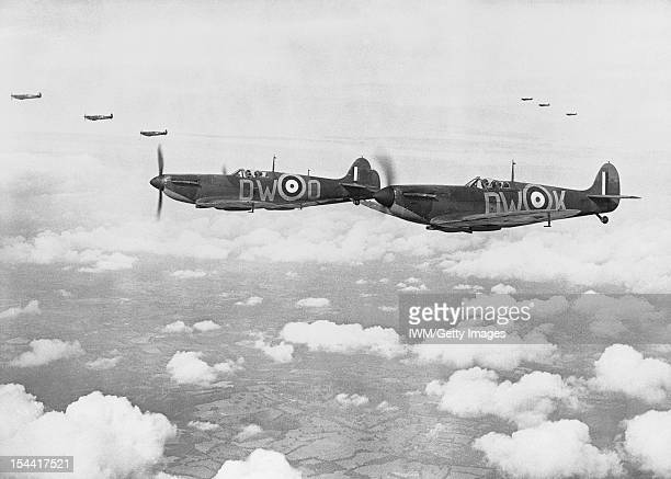 Supermarine Spitfire Mark IAs, , of No 610 Squadron, Royal Air Force based at Biggin Hill, Kent, flying in three 'vic' formations, during the Battle...