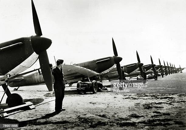 Supermarine Spitfire Mk I single-seat fighter aircraft from No. 19 Squadron RAF in line on an airfield during World War II, circa 1940. The Spitfire...