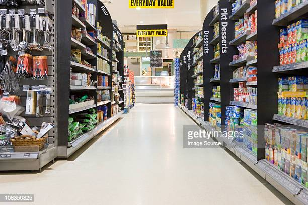 supermarket aisle - store stock pictures, royalty-free photos & images