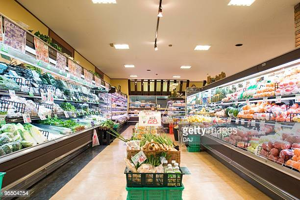 supermarket aisle - produce aisle stock photos and pictures