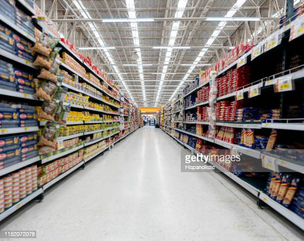 supermarket aisle with shelfs full of a variety of products - groceries stock pictures, royalty-free photos & images