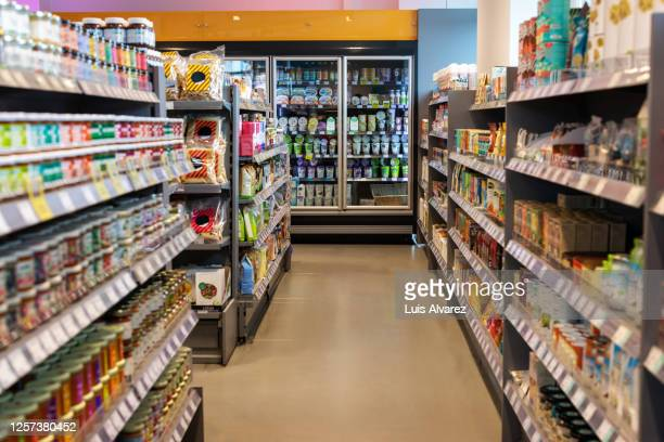 supermarket aisles with variety of products - groceries stock pictures, royalty-free photos & images