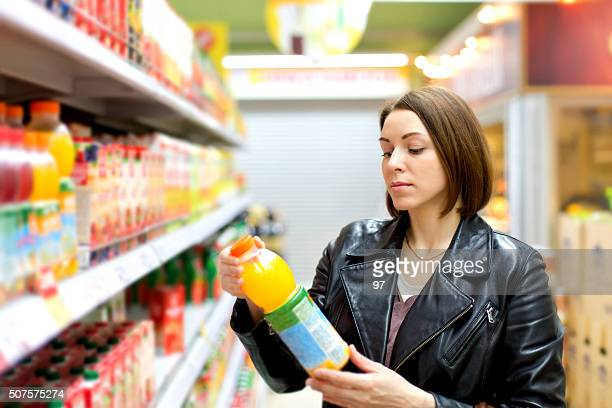 supermarket buying a bottle of juice - cold drink stock pictures, royalty-free photos & images