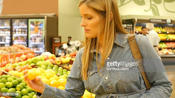 Supermarket customer shops in produce department