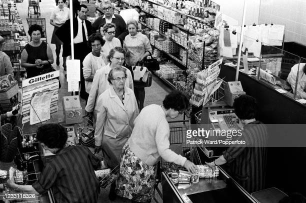 Supermarket customers queueing at the tills in West London, circa July 1969. From a series of images to illustrate the many frustrations of living in...