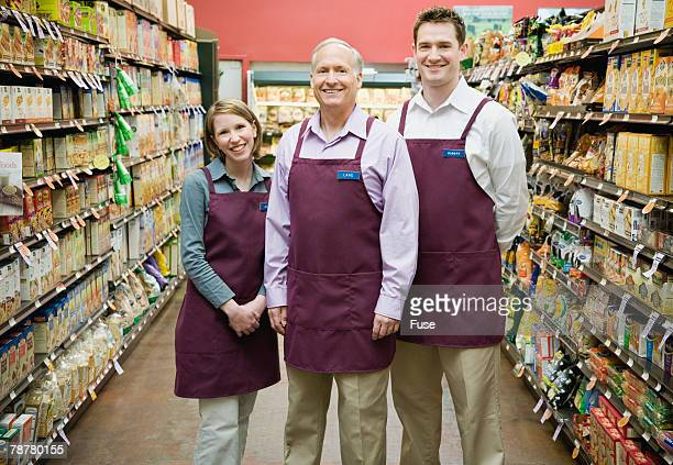Supermarket Employees Standing in Aisle