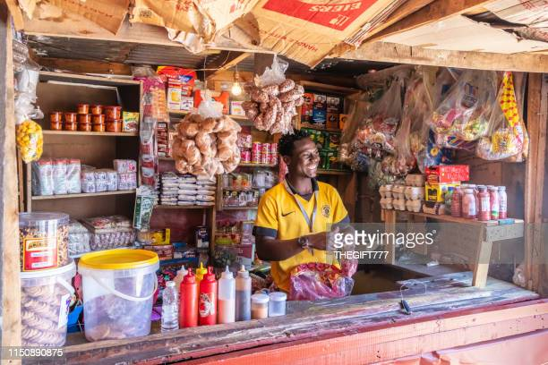 supermarket kiosk and attendant in alexandra township, johannesburg - gauteng province stock pictures, royalty-free photos & images