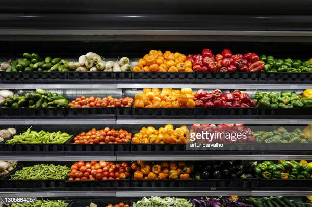 supermarket organic vegetables shelf - supermarket stock pictures, royalty-free photos & images