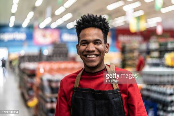 supermarket salesman portrait - assistant stock pictures, royalty-free photos & images