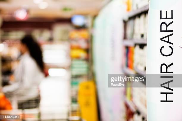 Allée de supermarché Shampooing