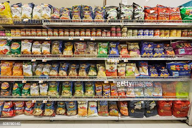 Supermarket shelf at a Kings Food Market in Midland Park, New Jersey filled mostly with Frito-Lay brands of chips.