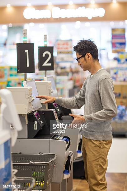 Supermarket shopper using a digital cash register and check-out system