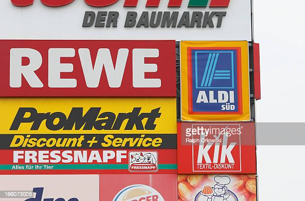Supermarket signs are pictured on April 8 2013 in GrossGerau near Frankfurt Germany Aldi which today is among the world's most successful discount...