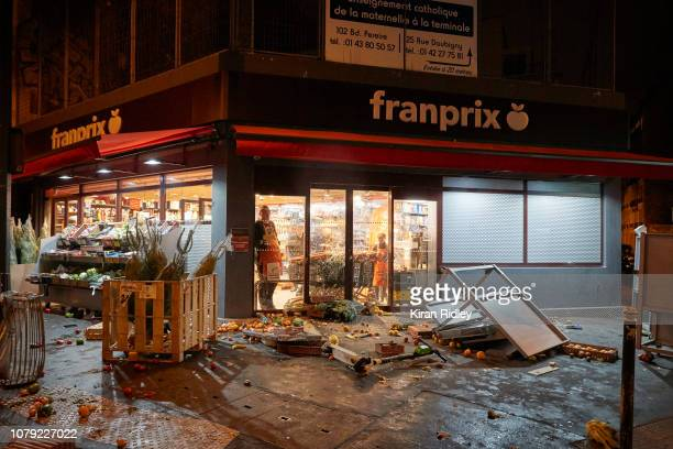 Supermarket staff look out after violence and looting following the daytime Gilet Jaune protest on December 8 2018 in Paris France The Yellow Vest...