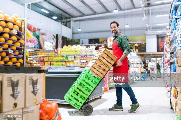 supermarket stocker portrait - produce aisle stock pictures, royalty-free photos & images