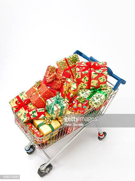 Supermarket trolley filled with christmas presents