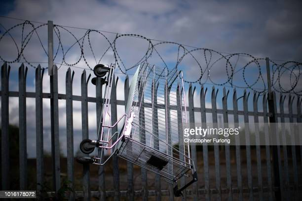 A supermarket trolley hangs on a barbed wire fence in the centre of town in the Black Country which was among the 29 out of 30 West Midlands voting...