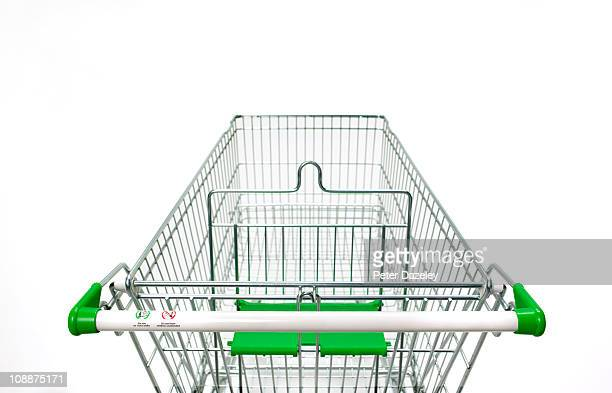 supermarket trolley on white background - shopping trolley stock pictures, royalty-free photos & images