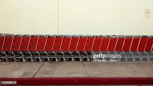 Supermarket Trolleys Against Wall
