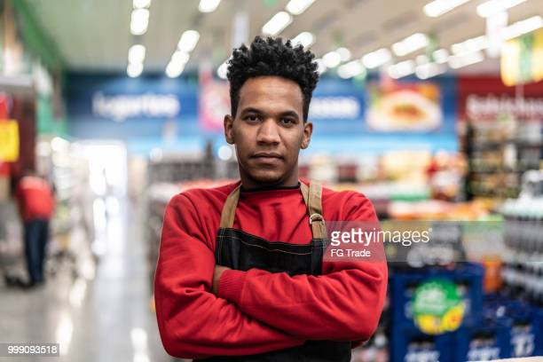supermarket worker portrait - small faces stock pictures, royalty-free photos & images