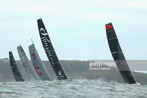 Supermaxi Comanche Supermaxi Perpetual Loyal Supermaxi Wild Oats XI and Rambler race during the 2015 Sydney to Hobart on December 26 2015 in Sydney...