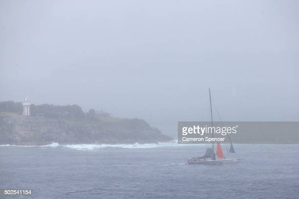 Supermaxi Wild Oats XI returns to Sydney with a torn mainsail after retiring from the 2015 Sydney to Hobart on December 27 2015 in Sydney Australia