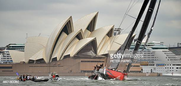 US supermaxi yacht Comanche sails in her first ever race in front of the Sydney Opera House during the SOLAS Big Boat Challenge on Sydney Harbour on...