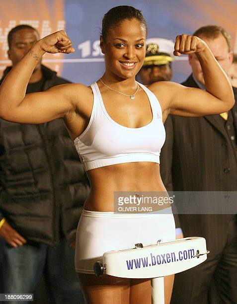 Supermiddle weight boxer Laila Ali of the US strikes a pose during a weighin in Berlin 16 December 2005 Ali will fight Asa Maria Sandell of Sweden in...