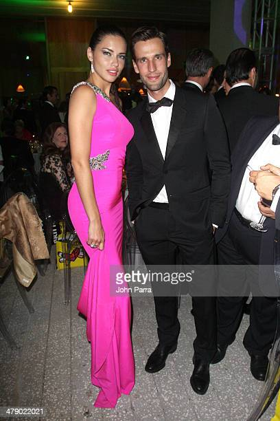 Supermodel Adriana Lima and Journalistactormodel Pedro Andrade attend the third annual BrazilFoundation Gala Miami at Perez Art Museum Miami on March...