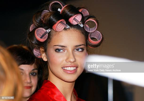 Supermodel Adriana Lima with her hair in curlers backstage before the Victoria's Secret Fashion Show at Bryant Park