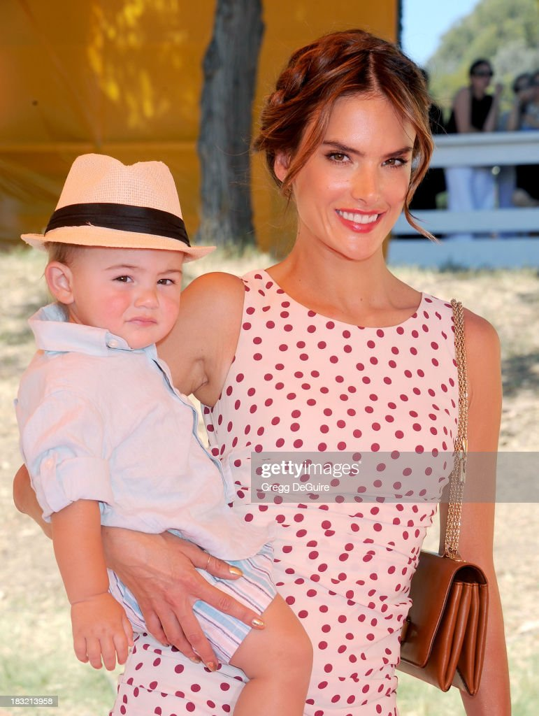 Supermodel Alessandra Ambrosio and son Noah Phoenix Ambrosio Mazur arrive at the Veuve Clicquot Polo Classic at Will Rogers State Historic Park on October 5, 2013 in Pacific Palisades, California.