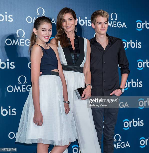 Supermodel and OMEGA Ambassador Cindy Crawford poses with her daughter Kaia Gerber and son Presley Gerber as they attend 'The Hospital In The Sky'...