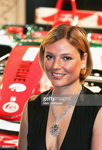 Supermodel Bridget Hall poses with a Steinmetz diamond necklace and the new liveried Jaguar R5 during preparations for the Monaco F1 Grand Prix on...