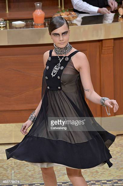 Supermodel Cara Delevingne walks the runway at the Chanel Autumn Winter 2015 fashion show during Paris Fashion Week on March 10 2015 in Paris France