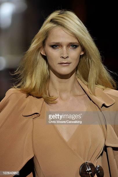 Supermodel Carmen Kass walks the runway during the Giorgio Armani Prive fashion show at Paris Haute Couture Fashion Week for Autumn Winter 2010 on...
