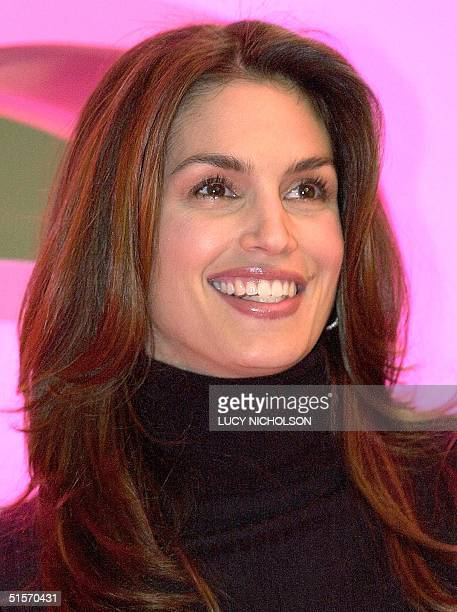 US supermodel Cindy Crawford attends the launch of WE Women's Entertainment cable network at the Western Show in Los Angeles 29 November 2000 AFP...