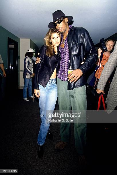 Supermodel Cindy Crawford poses for a photo with Dennis Rodman of the Chicago Bulls before playing against the Seattle SuperSonics in Game Three of...